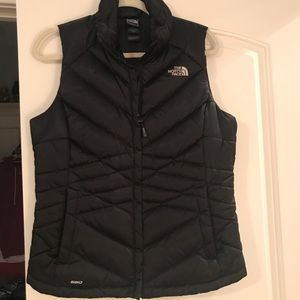 The north face black puffy vest
